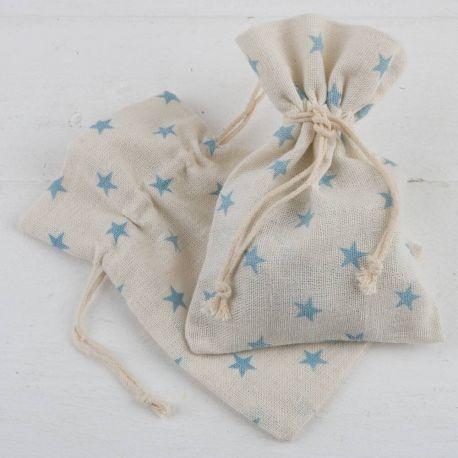 Empaquetado saquito beige y estrellas azules . Pack 48 unidades bolsa algodón (0,99 euros). …