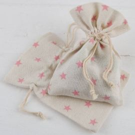 Empaquetado saquito beige y estrellas rosas . Pack 48 unidades bolsa algodón (0,99 euros unidad)