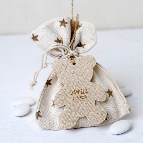 """Saco decorado """"Estrellas"""" con 5 peladillas y colgante oso beige"""
